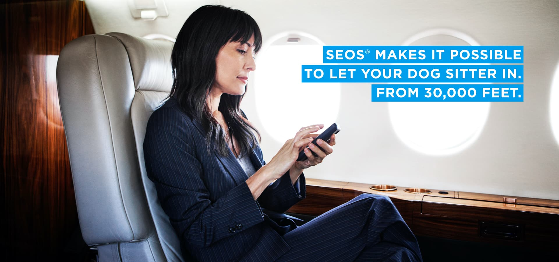 Woman using SEOS app from her airplane seat